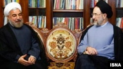 Iran's recently elected President Hassan Rohani (left) meets with former President Mohammad Khatami at his home in Tehran in June 2013.