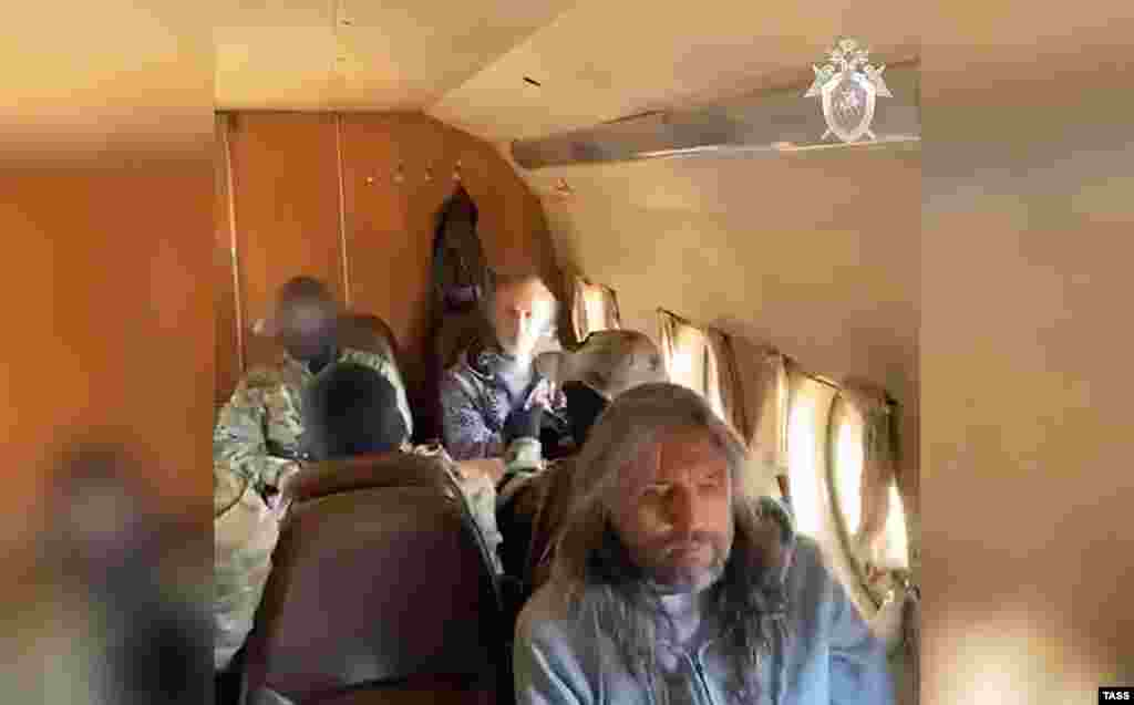 Vissarion is transported by plane after being detained along with two senior members of his organization by Federal Security Service (FSB) agents on September 22.
