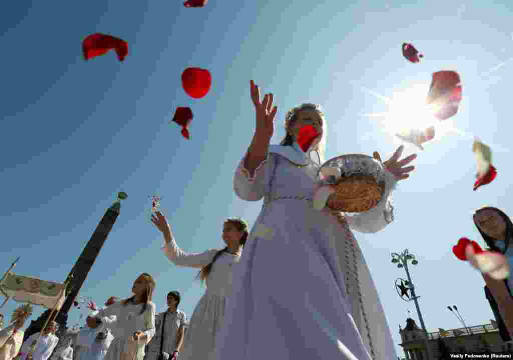 Catholic faithful throw petals during a procession marking the Feast of Corpus Christi in Minsk, Belarus, on June 2. (Reuters/Vasily Fedosenko)