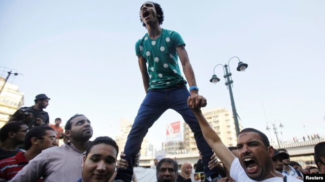 Supporters of the Muslim Brotherhood shout slogans against the military and Interior Ministry during a protest in front of the Al-Istkama Mosque on Giza Square, south of Cairo, on August 18.