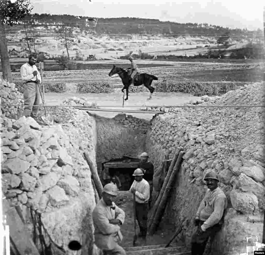 An undated photo shows French soldiers posing in a trench at Suippes on the Champagne front in eastern France. From the viscount's collection.