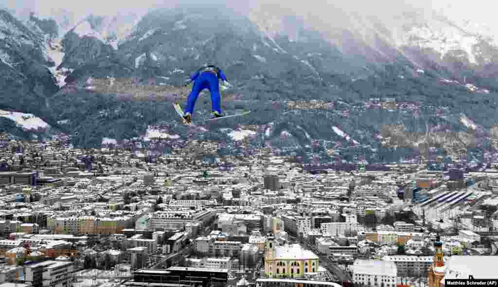 Switzerland's Killian Peier soars through the air during a trial jump at the third stage of the 67th Four Hills ski-jumping tournament in Innsbruck, Austria. (AP/Matthias Schrader)