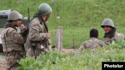 Nagorno-Karabakh - Armenian soldiers at an artillery position in southeastern Karabakh, 5Apr2016.