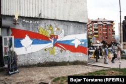 "A mural in Mitrovica stating that ""Kosovo is Serbia and Crimea is Russia."""