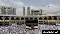 Muslim pilgrims congregate around the Kaaba, the cubic building at the Grand Mosque, ahead of the Hajj pilgrimage in the Muslim holy city of Mecca, on August 8.