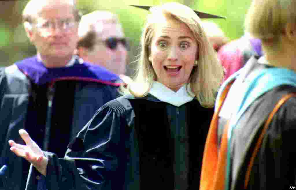 Clinton greets friends at an academic procession before the 1992 graduation ceremony at Wellesley College, where she was the keynote speaker. Clinton had been the president of the student government at Wellesley before earning her law degree from Yale Law School in 1973.