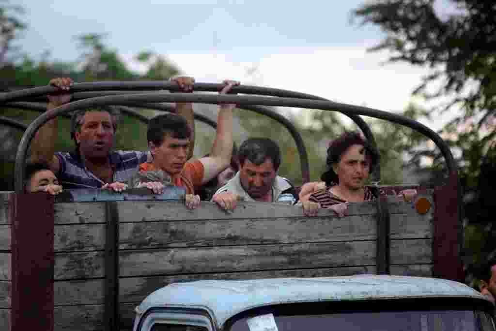 Ethnic Georgians from the villages surrounding Tskhinvali flee the conflict zone on August 8.