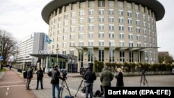 NETHERLANDS -- Journalists wait outside the headquarters of the Organisation for the Prohibition of Chemical Weapons (OPCW) in The Hague, April 4, 2018