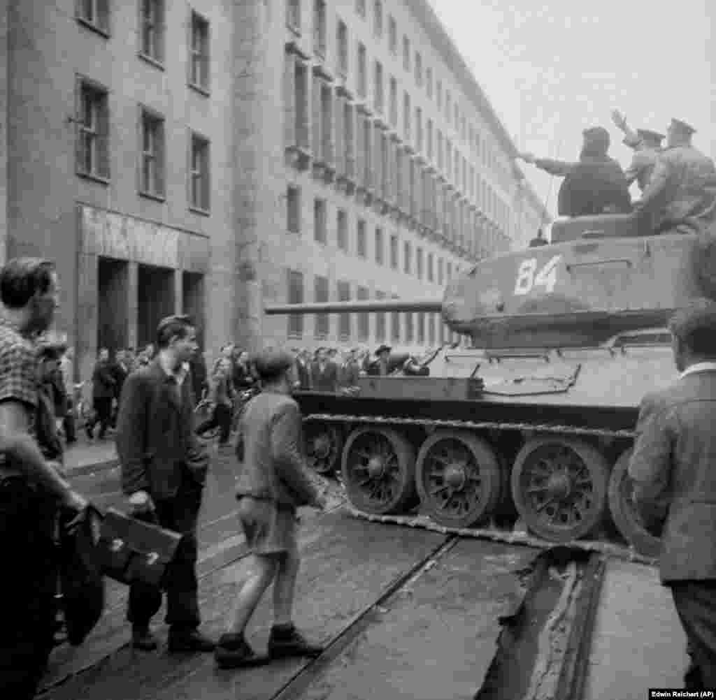 A Soviet T-34 amid a crowd of demonstrators in East Berlin during the East German uprising, June 17, 1953.