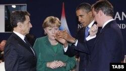 """Участники саммита """"группы 20-и"""" - президент Франции Николя Саркози, канцлер Германии Ангела Меркель, президент США Барак Обама и премьер-министр Великобритании Дэвид Кэмерон (слева направо)"""
