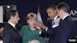 Президент Франции Николя Саркози, канцлер ФРГ Ангела Меркель, президент США Барак Обама и премьер-министр Великобритании Дэвид Кэмерон (слева направо) на саммите G20.