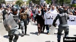 Afghan riot police clashed with demonstrators during an antigovernment protest in Kabul on June 2. At least five people were killed in the violence.