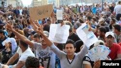 """Будапешттин """"Келети"""" темир жол бекетиндеги мигранттардын нааразылык акциясы."""