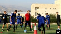 Iran's national football team Head Coach Carlos Queiroz, center, conducts a training session a day ahead of a Group A match against Syria during the 2018 FIFA World Cup Russia Qualifier in Tehran, Iran, Monday, Sept. 4, 2017. Millions of Syrians may final