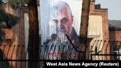 A picture of Qassem Soleimani, head of the elite Qods Force, who was killed in an air strike, is seen on the former U.S. Embassy's building in Tehran, January 7, 2020