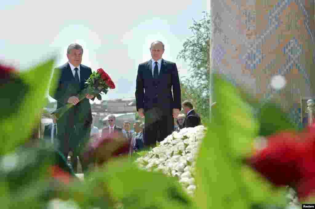 Президент России Владимир Путин и премьер-министр Узбекистана Шавкат Мирзиеев