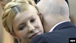 Юлия Тимошенко и ее муж Александр в суде. Киев, осень 2011 года