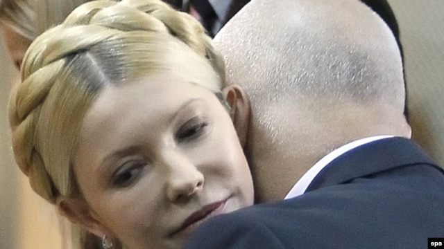 Yulia Tymoshenko is embraced by her husband, Oleksandr, during her verdict hearing in Kyiv on October 11.