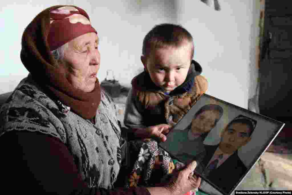 Isaeva shows her grandson Kurbanbek a picture of herself and her late husband Abdusaim, whom she married at age 15. Abdusaim wrote in his will that the family should stay in the village where they were born.