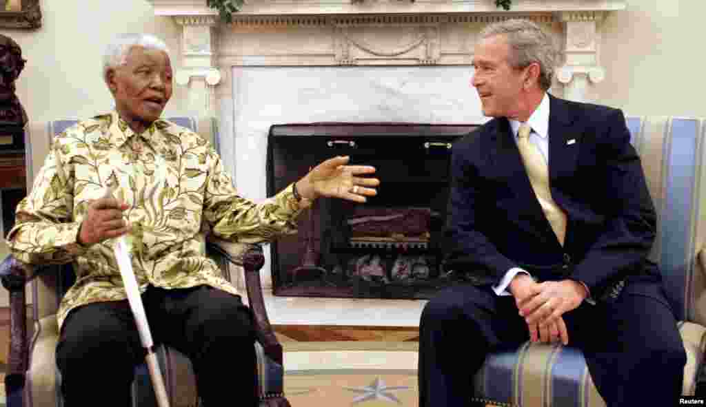 U.S. President George W. Bush meets with Nelson Mandela in the Oval Office of the White House in May 2005.