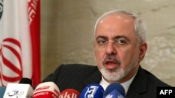 Iranian Foreign Minister Mohammad Javad Zarif attends a press conference in Kuwait on July 26.