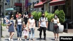 Armenia -- Pedestrians wear face masks in downtown Yerevan, July 10, 2020.