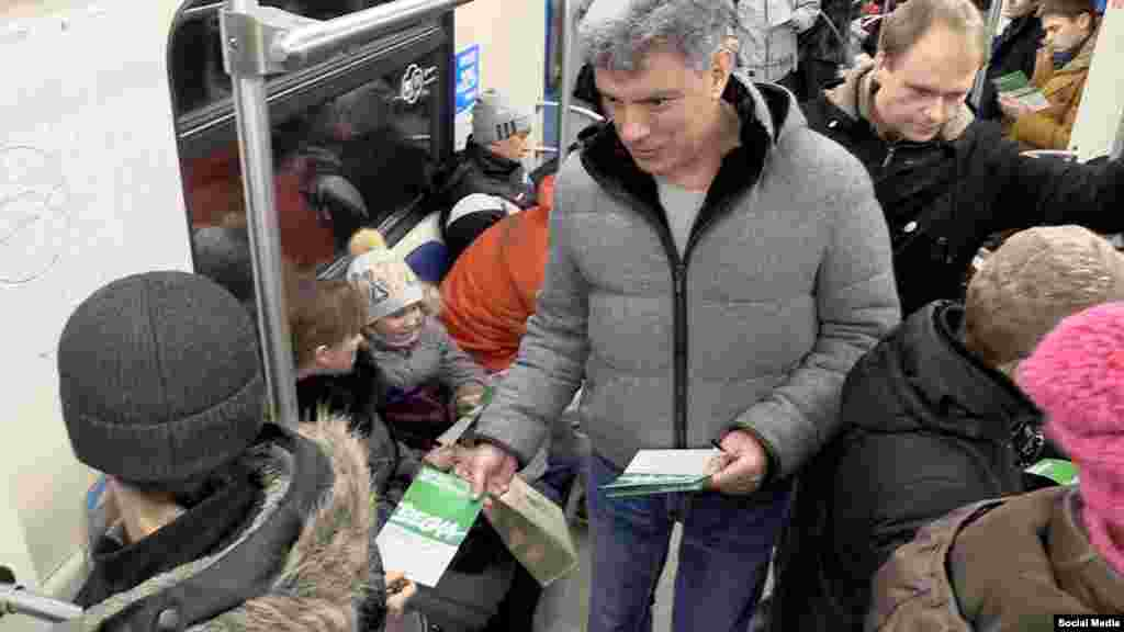 Nemtsov hands out leaflets inviting people to come to an opposition rally in Moscow in February 2015.