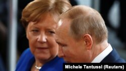 German Chancellor Angela Merkel (left), in talks with Russian President Vladimir Putin in January 2020, will retire from politics after elections next month.