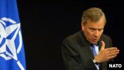 NATO Secretary-General Jaap de Hoop Scheffer is seeking an elusive consensus.