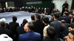 Former president Mahmoud Ahmadinejad sitting at the very end of the top row (to the right of the photo) in mourning ceremony chaired by Supreme leader, Khamenei.