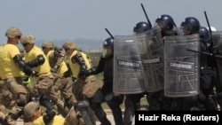 The NATO led-peacekeeping force KFOR and Kosovo Police conduct a joint crowd- and riot-control drill in Pristina.