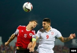 Lorik Cana (left) of Albania in action against Nemanja Gudelj of Serbia during the match.