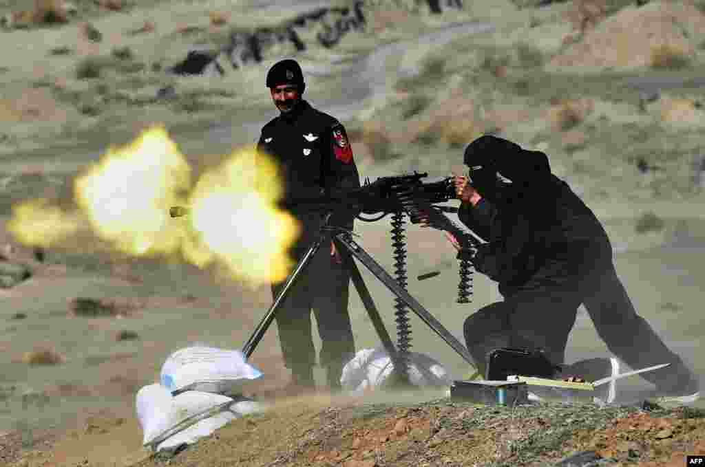 A Pakistani policewoman fires a heavy machine gun during a special training course in Nowshera, a district in Khyber Pakhtunkhwa Province, on February 11. (AFP/A Majeed)