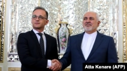 Iranian Foreign Minister Mohammad Javad Zarif (R) receives his German counterpart Heiko Maas in the capital Tehran, June 10, 2019
