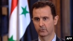 Syrian President Bashar al-Assad says Russian support for his government is stronger than ever. (file photo)