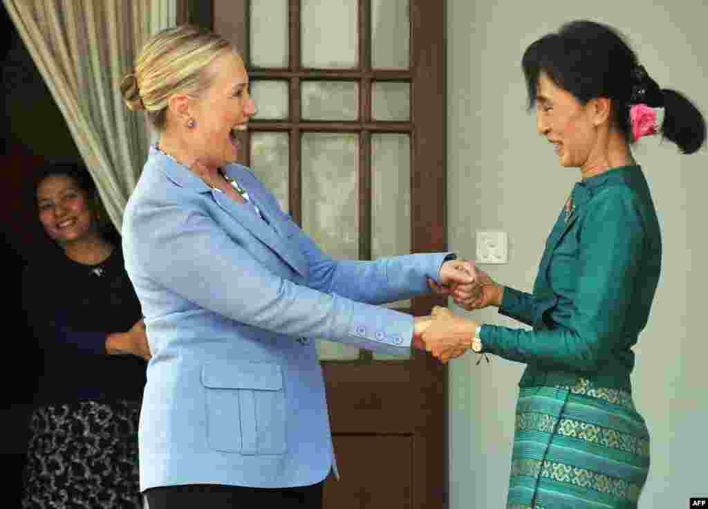 Suu Kyi greets U.S. Secretary of State Hillary Clinton following a meeting at Suu Kyi's residence in Yangon on December 2, 2011.