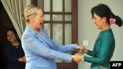 Myanmar opposition leader Aung San Suu Kyi (right) with U.S. Secretary of State Hillary Clinton following a meeting at Suu Kyi's residence in Yangon on December 2, 2011.