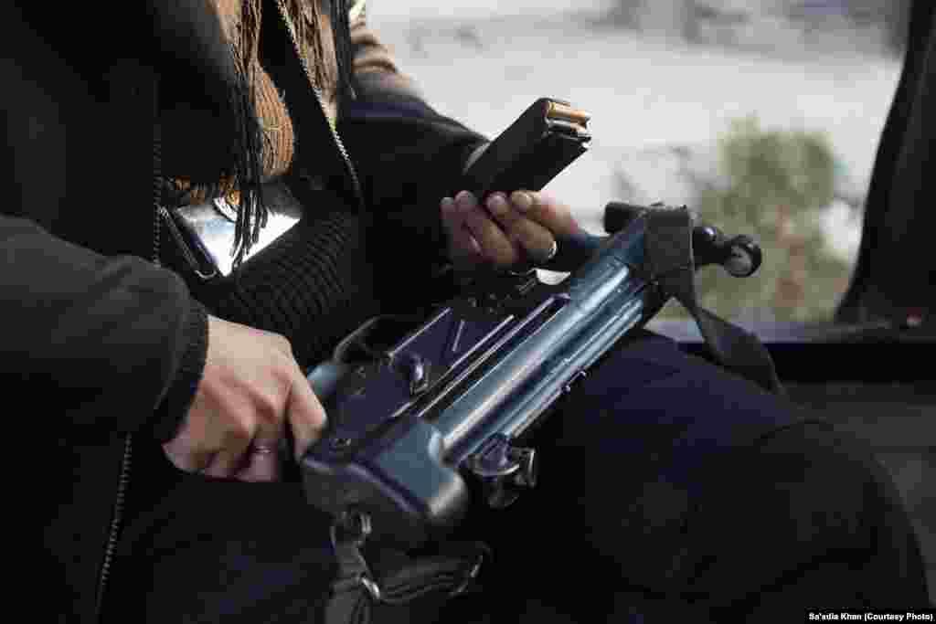 Glock 5 sub-machine guns used by the ATS female commandos.