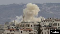 Идлиб шаары аткылоолордон соң. 11-март, 2012-жыл.