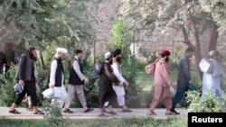 Newly freed Taliban prisoners walk out of Pul-e Charkhi prison in Kabul on August 13.