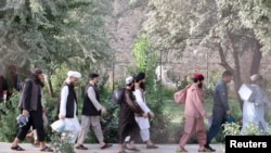 Newly freed AfghanTaliban prisoners walk inside the Pul-e-Charkhi prison in Kabul on August 13.