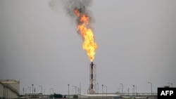 Flames rise from the burning of excess oil at the West Qurna-2 oilfield, west of Basra, April 17, 2017