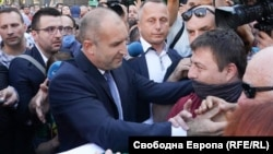 Bulgarian President Rumen Radev (left) came out and thanked protesters for their support.
