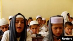 Afghan boys read the Koran at a madrasah or religious school in Kabul. (file photo)