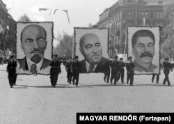 Communist leader Matyas Rakosi (center), paraded alongside portraits of Lenin and Stalin in 1950.