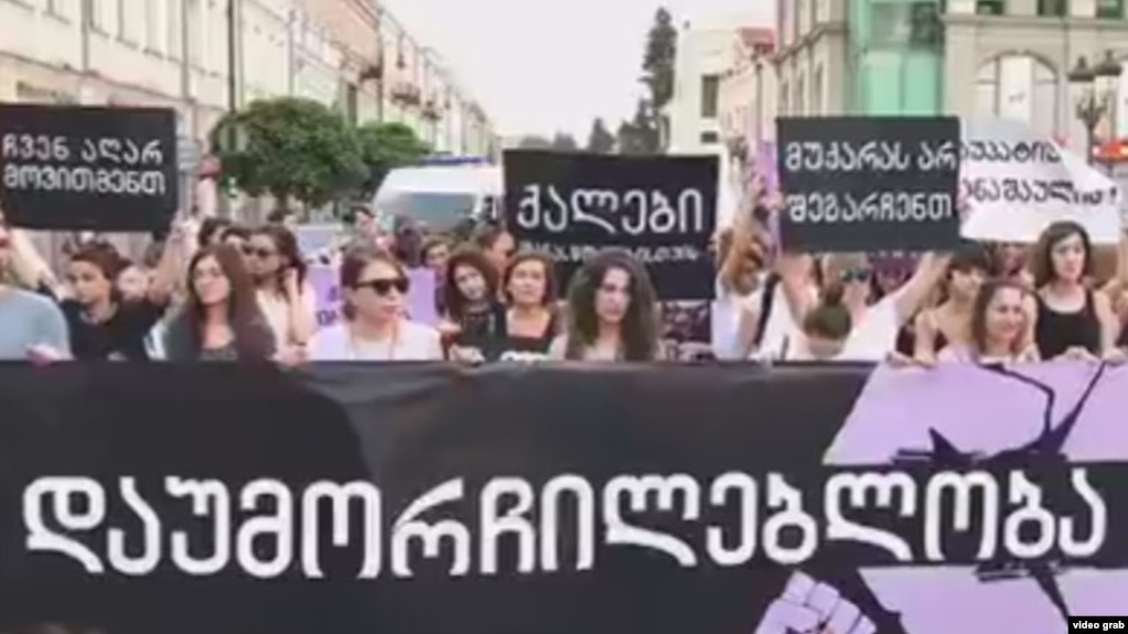 Women rights defenders march against violence in Tbilisi on July 19.