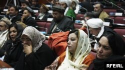 Afghan parliament members vote on the cabinet nominees in Kabul on January 2.