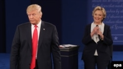 Hillary Clinton (right) and Donald Trump debate on October 9, 2016, before the U.S. election.