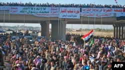 Iraqi protesters pray during a demonstration in Ramadi, capital of the western region of Anbar, on December 28.