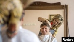 Russian cosmonaut Gennady Padalka gets his hair cut while he on Earth earlier this year.